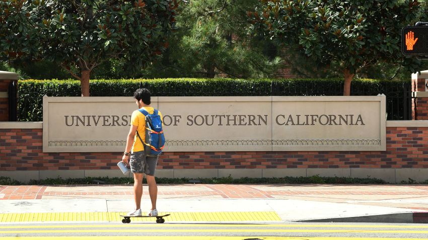 A skateboarder commutes at the University of Southern California.
