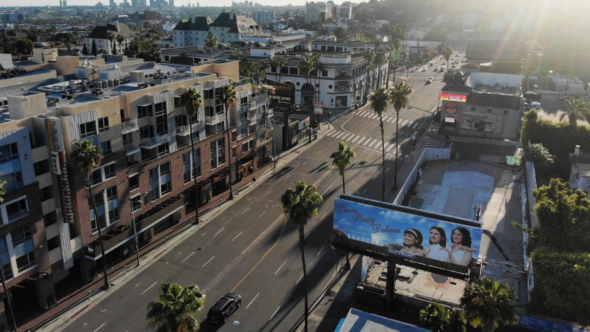 An aerial view shows light traffic passing on Sunset Boulevard in Los Angeles on April 15, 2020.