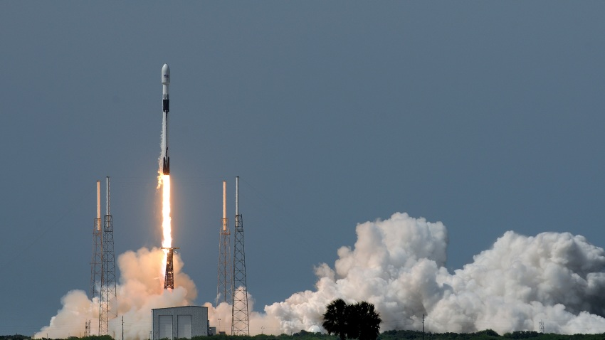 A SpaceX rocket lifts off.