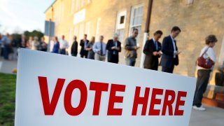 Voters line up to cast their ballots on Super Tuesday