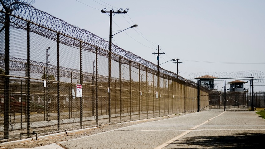 The California Institution for Men prison fence is seen on August 19, 2009 in Chino, California. Up until an inmate from the California Institution for Women in Corona died on Tuesday from what appear to be complications related to the coronavirus, it was the sole site of virus-related deaths in California prisons.
