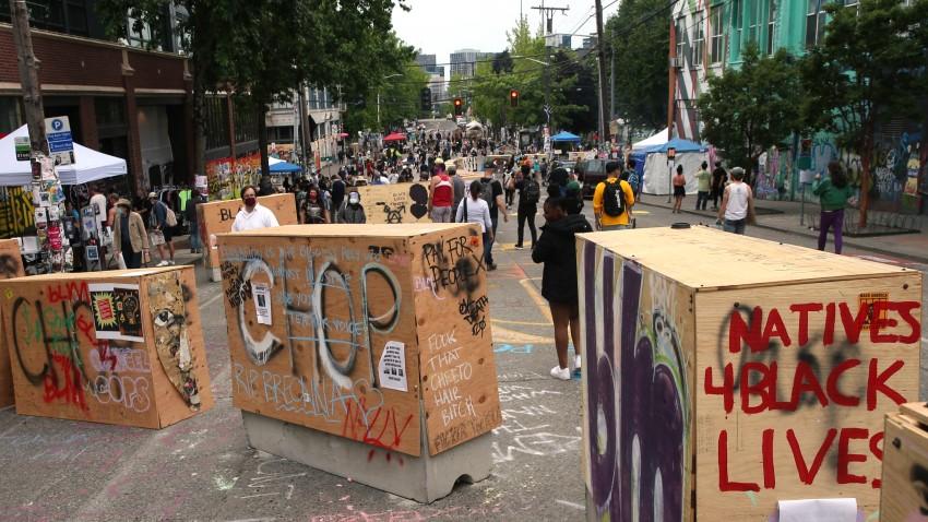 Barricades erected by the city several days ago divide up the CHOP zone on June 19, 2020 in Seattle, Washington. The concrete barriers, wrapped in plywood for painting, were installed to protect the free speech zone while still allowing one lane of traffic to get through. Nevertheless, protesters have blocked off entrances to traffic.