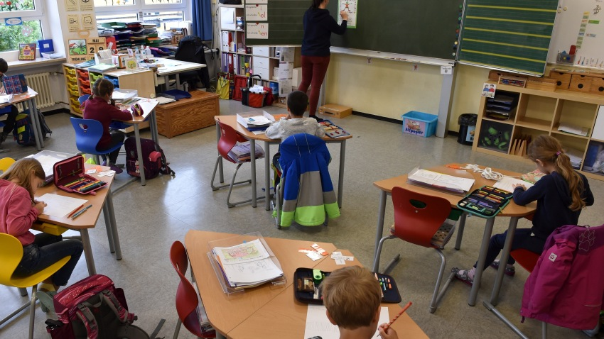Students sit in a classroom at a primary school in Eichenau, southern Germany, on June 16, 2020 amid the novel coronavirus COVID-19 pandemic. - The pupils sit at a distance from each other and attend school in smaller classes until the summer holidays due to the pandemic.