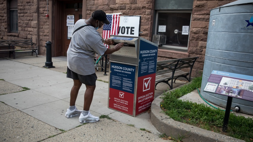 Voter drops off ballot