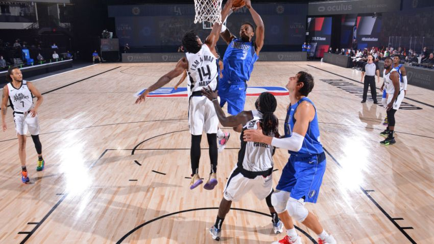 Antonius Cleveland #3 of the Dallas Mavericks shoots the ball against the LA Clippers during Round One, Game Five of the NBA Playoffs on August 25, 2020 at the AdventHealth Arena at ESPN Wide World Of Sports Complex in Orlando, Florida.