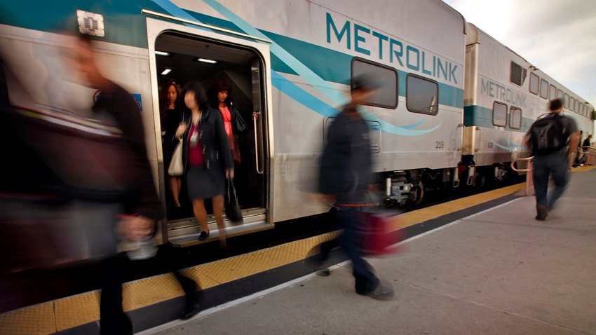 Incoming Metrolink passengers deboard the train at Union Station.
