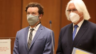 Actor Danny Masterson, left, stands with his attorney, Thomas Mesereau as he is arraigned on rape charges at Los Angeles Superior Court, in Los Angeles, Calif. on Friday, Sept. 18, 2020.