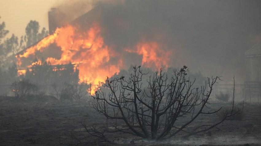 A house burns during the Bobcat Fire on September 18, 2020 in Juniper Hills, California