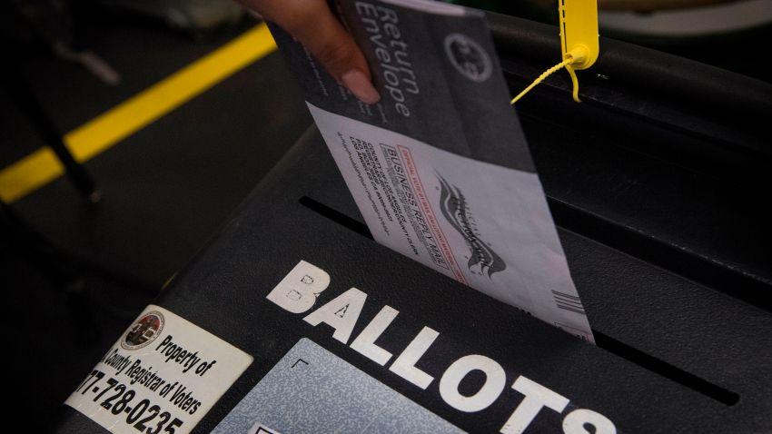 A woman casts her ballot.