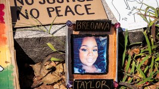 A sign with a picture of Breonna Taylor lays aside the path of a march at Cadman Plaza in Brooklyn, July 25, 2020.