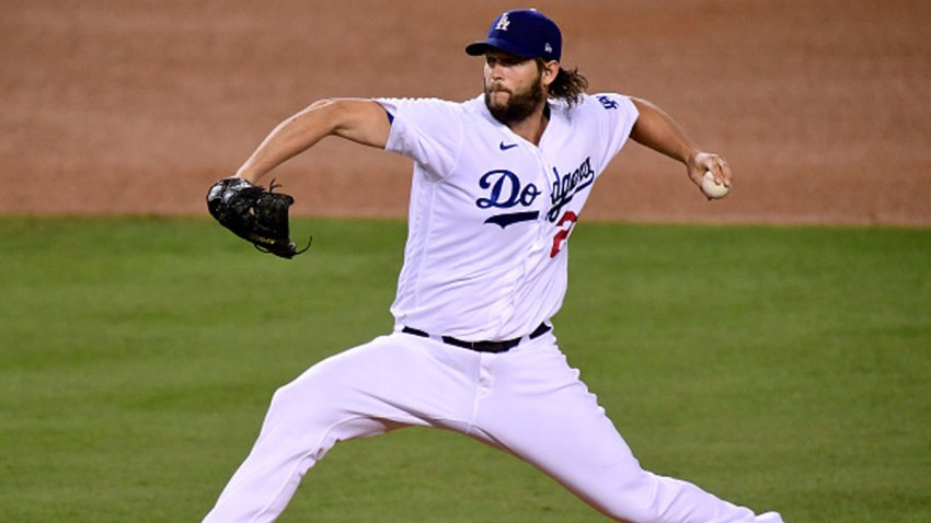 Clayton Kershaw #22 of the Los Angeles Dodgers pitches against the Milwaukee Brewers during the third inning in game two of the National League Wild Card Series at Dodger Stadium on Oct. 1, 2020 in Los Angeles, California.