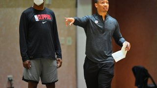 Tyronn Lue of the LA Clippers coaches during practice.