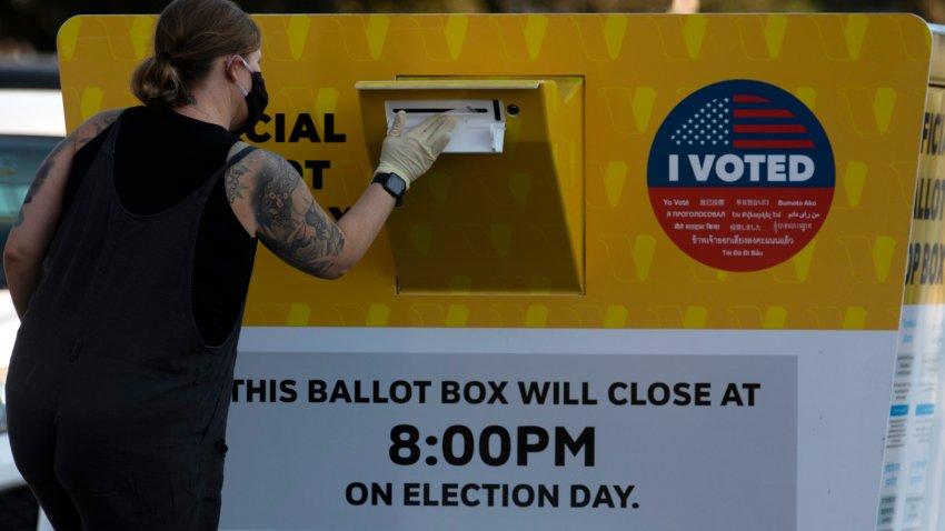 Voters cast ballots.
