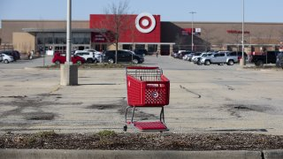 A shopping cart in the parking lot outside a Target store in Shorewood, Illinois,