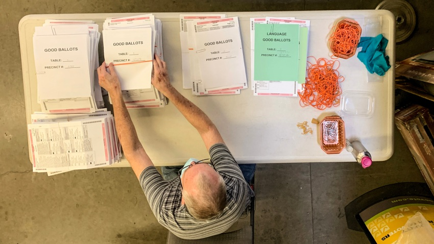 A worker processes ballots at the Orange County Registrar of Voters in Santa Ana.