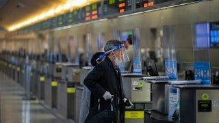 International travelers pass through a nearly empty LAX Tom Bradley International Terminal.