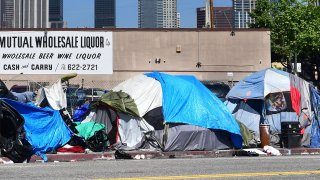 Tents housing the homeless line a street in downtown Los Angeles.