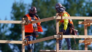 Construction workers talk at a USA Properties Fund site