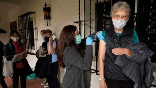 Registered nurse Liliana Ocampo, center, administers a Moderna COVID-19 vaccine to retired nun, Sister Linda Snow, at The Sisters of St. Joseph of Carondelet independent living center in Los Angeles, Wednesday, March 3, 2021. Boys & Girls Clubs of W. San Gabriel Valley's mobile Pop-up RV in partnership with Monterey Park Hospital AHMC, help administer the vaccine to 50 retired nuns.