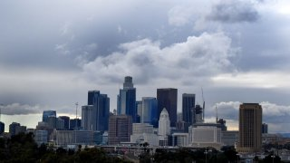 Rain clouds roll across downtown in Los Angeles.