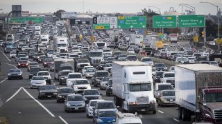 Vehicles in traffic travel along Interstate 80 in Emeryville, California, U.S., on Thursday, Sept. 27, 2018.