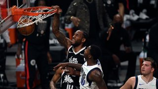Kawhi Leonard #2 of the Los Angeles Clippers dunks the ball against Dorian Finney-Smith #10 of the Dallas Mavericks during the first half of Game Seven of the Western Conference first round series at Staples Center on June 6, 2021 in Los Angeles, California.