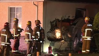 Firefighters at the scene of a SUV crash in Baldwin Hills.