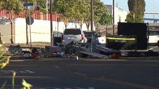 A crumpled guard shack at the scene of a hit-and-run crash in Long Beach.