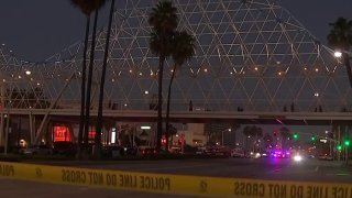 Crime scene tape at the scene of a shooting in downtown Long Beach.