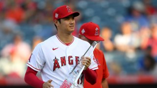 Shohei Ohtani #17 of the Los Angeles Angels was presented with his MVP of the month award before the Seattle Mariners at Angel Stadium of Anaheim on July 16, 2021 in Anaheim, California.
