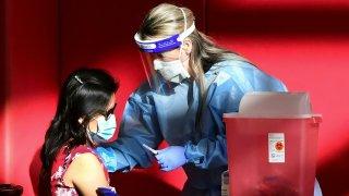 vacuna del COVID en mujeres